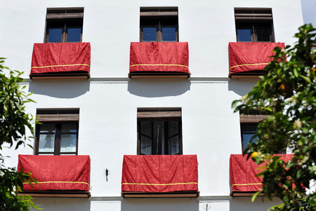 Balcony decorated for a religious holiday, Easter week, Seville, Andalusia, Spain Stock Photo