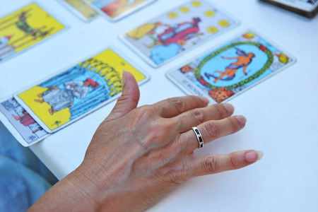 divining: Guess woman throwing the tarot cards Stock Photo