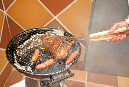 chorizos: Cooking a barbecue for friends in the backyard Stock Photo