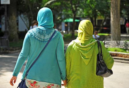 Two veiled Muslim women walking in the garden