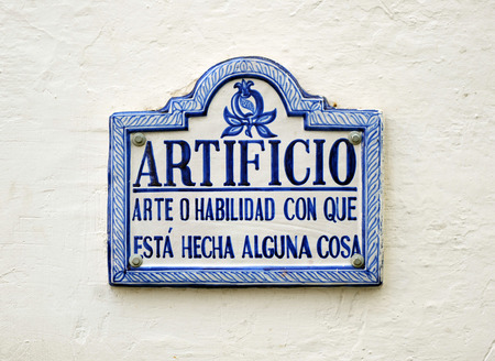 artifice: Definition of the word artifice, tile in the streets of Granada, Andalusia, Spain Stock Photo