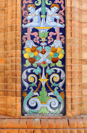 pilaster: Pilaster of decorative tiles on the facade of a manor house, vintage ceramic in architecture Stock Photo