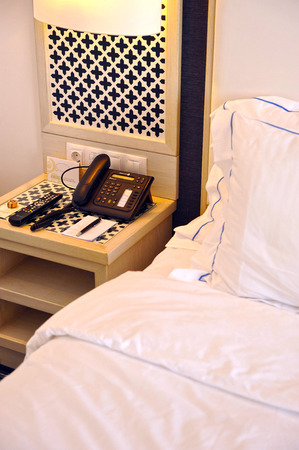 Bedside table with telephone, bedroom hotel, accommodation, bed pillows, comfortable room