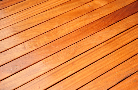 building material: Teak slatted floor wet from the rain, a luxury terrace housing, building material