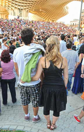 Young couple in the crowd, popular expression, claims people