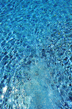Clear blue water, swimming pool, water jet, summer vacation Banco de Imagens