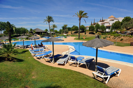 Sun loungers and parasols by the pool, summer vacation, Andalusia, Spain