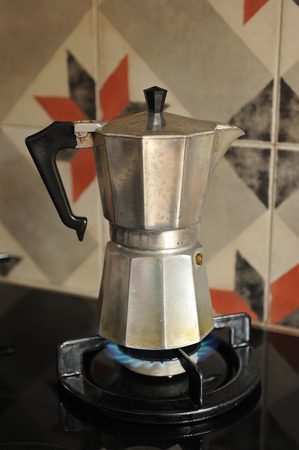 coffeemaker: Early morning breakfast, making coffee with an old coffeemaker, Stock Photo