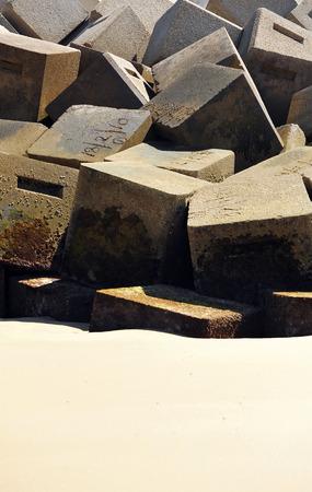 groyne: Groyne on the beach, breakwater, concrete blocks, cubes, Costa de la Luz, Cadiz, Andalusia, Spain