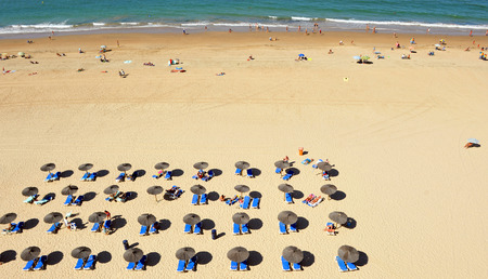 loungers: Sun loungers and parasols, panoramic view from above, Victoria Beach, Costa de la Luz, Cadiz, Andalusia, Spain Stock Photo
