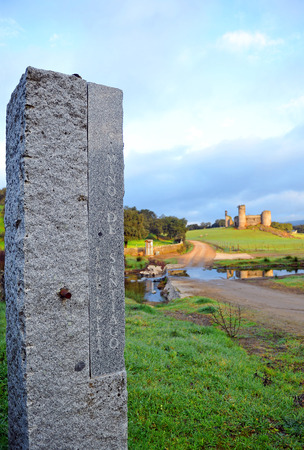 pilgrim journey: Stone monolith on the Camino de Santiago, Real de la Jara, Sevilla province, Andalusia, Spain Editorial