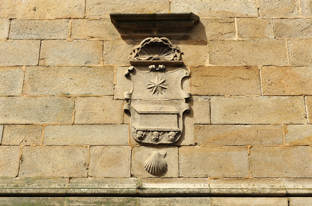 Stone coat of arms in the streets of Santiago de Compostela, Galicia, Spain photo