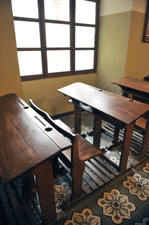 baccalaureate: Wooden desks in a old school