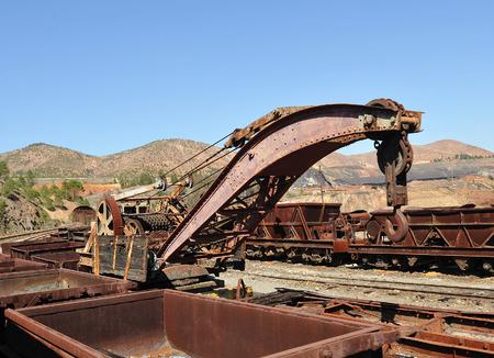 Railway crane, old railroad cars abandoned mineral transport, Rio Tinto mines, Huelva province, Spain photo