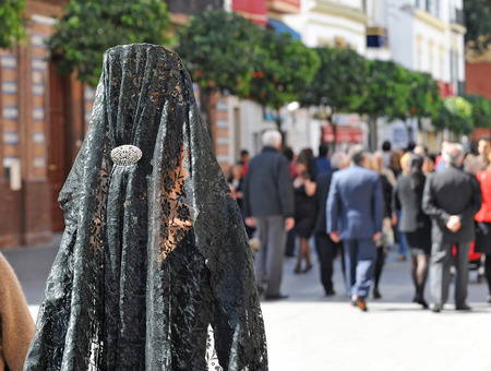 holy week in seville: Woman with veil and ornamental comb for Good Friday, Holy Week, Seville, Spain,
