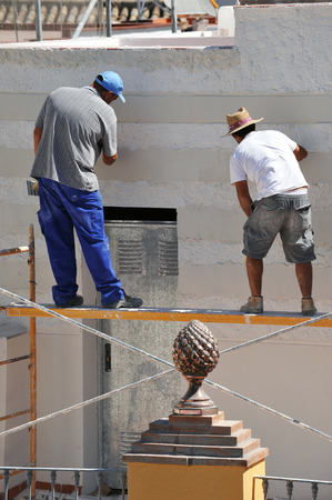 repeal: Two bricklayers working on building a house Stock Photo