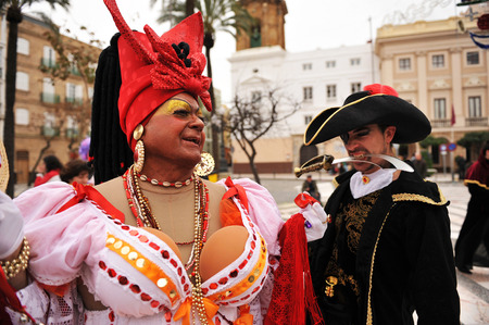 Carnival disguises on the street, Pirate and Caribbean woman, Cadiz, Andalusia, Spain