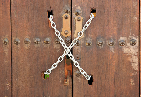 lordly: Closed wooden door with chain, close up