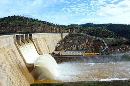 Panoramic view, Montoro reservoir full dam with the floodgates open, Ciudad Real province, Castilla la Mancha, Spain