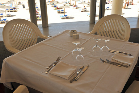 semibreve: Table prepared in a beach restaurant Stock Photo