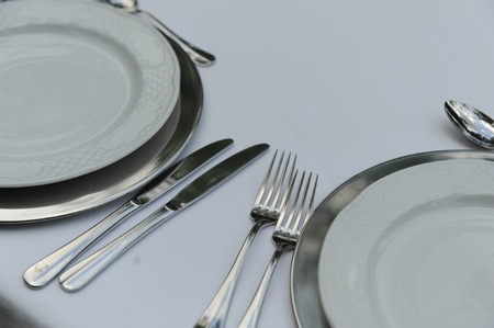 Detail dishware on a table set for a feast