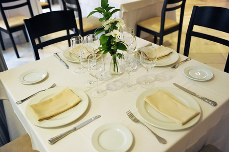 Table set for a banquet in restaurant Stock Photo
