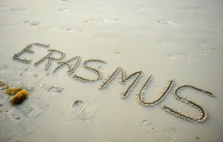 union beach: Erasmus written in the sand on the beach, university scholarship in Europe