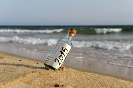 beach happy new year: Happy new year, 2015, bottle with message on the sand beach