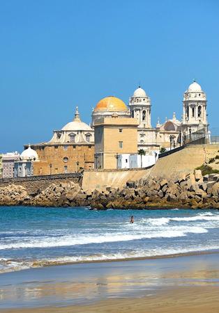sun bathers: Baroque Cathedral of Cadiz, Atlantic ocean, Andalusia, Spain