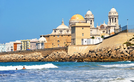 sun bathers: Baroque Cathedral, beaches of Cadiz, Andalusia, Spain Stock Photo