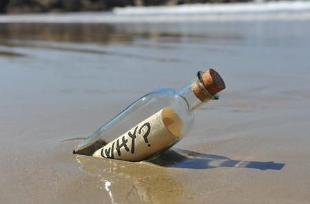 strangeness: Bottle with question, why? Stock Photo