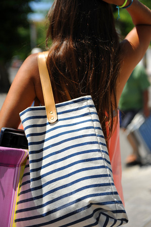 Young woman going to the beach, summer vacation, Spain photo