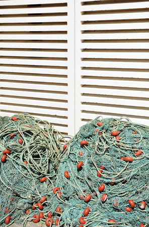 stored: Pile of fishing nets stored in the fishing port,  warehouse Stock Photo