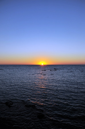 beaches of spain: sunset in the Atlantic Ocean, beaches of Chipiona, Andalusia, Spain