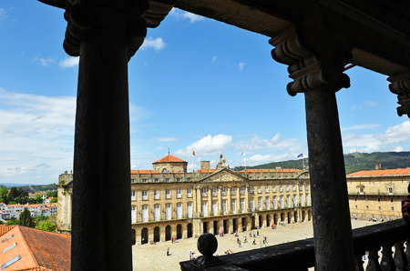rajoy: City Hall and Obradoiro Square in Santiago de Compostela with the city and pilgrims, Way of Santiago, Spain Editorial