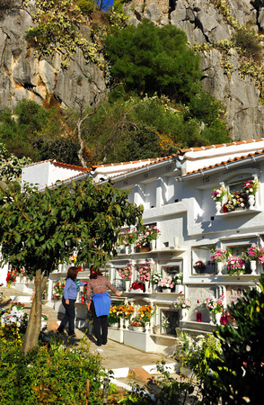 camposanto: Two women in the cemetery of Gaucin, celebrating the Day of All Saints, Andalusia, Spain
