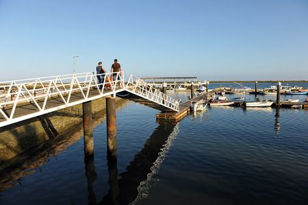 speedboats: Metal footbridge pier, the marina of Olhao, Atlantic Ocean, southern Portugal