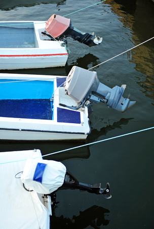 outboard: Outboard motor boats in the port Stock Photo