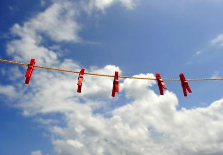 clothes rack: Plastic Tweezers, rack for clothes Stock Photo