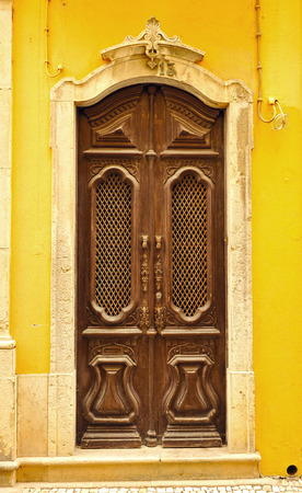 algarve: Portuguese door painted brown wooden, Olhao, Algarve, southern Portugal Stock Photo