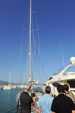 cuccette: Several men watching a sailboat in the marina, Marbella, Costa del Sol, Malaga province, Spain