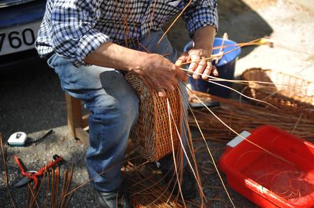 wicker work: Craftsman making handmade wicker baskets, Spain