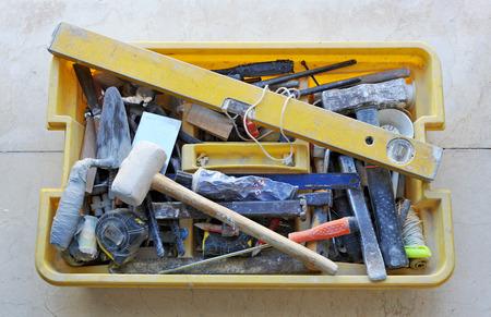 disorderly: Toolbox disorderly tools of a mason Stock Photo
