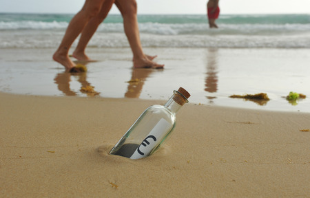 response time: Bottle with euro sign inside, couple walking on the beach