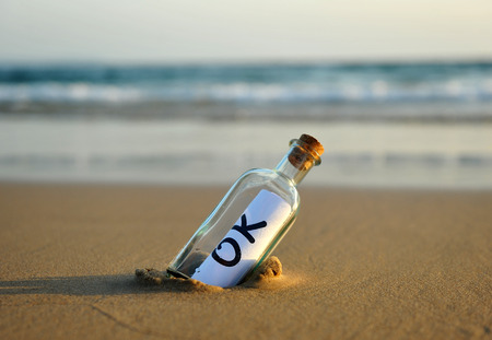 affirmative: Bottle on the beach with an affirmative answer inside, ok
