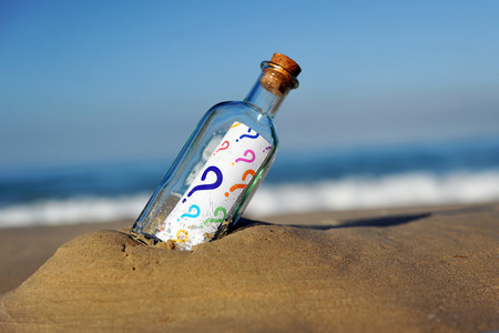 disparity: Bottle with questions of colors Stock Photo