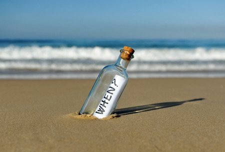 when: Bottle with question on the beach, when