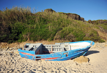necessity: Boat wrecked on the sea shore, immigration, Strait of Gibraltar, southern Europe