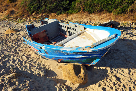 wrecked: Coasts of southern Europe, boat wrecked on the sea shore, immigration, Strait of Gibraltar,