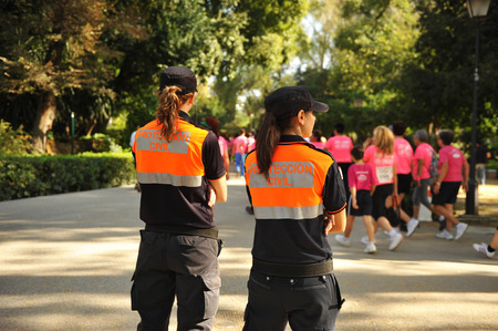 Two women of Civil Protection during a popular race, Spain